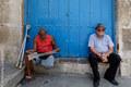 Man reading Granma, the organ of the Communist Party of Cuba, Havana Vieja
